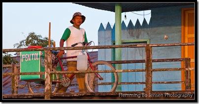 Borneo bicycle man. Flemming Bo Jensen Photography